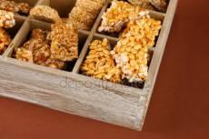 depositphotos_17184261-stock-photo-tasty-sweets-kozinakiin-wooden-crate